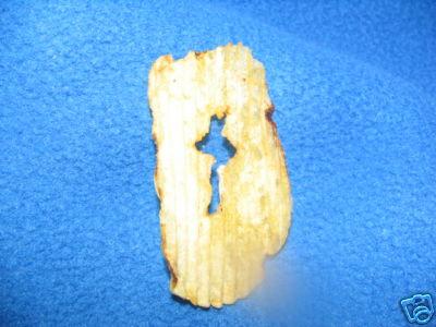 Cross in potato chip.